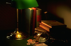 Mystery-books-with-magnifying-glass-300x197